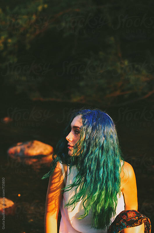 Beautiful girl with blue and green hair  by Giulia Squillace for Stocksy United