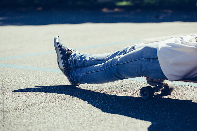 Resting on skateboard by michela ravasio for Stocksy United