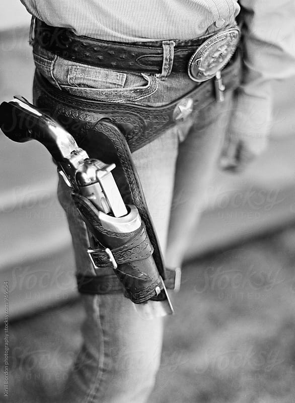 pistol in holster by Kirill Bordon photography for Stocksy United