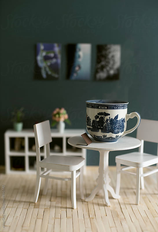 Large cup of coffee on table by Alita Ong for Stocksy United