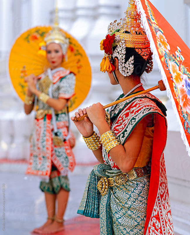 South East Asia, Thailand, Bangkok, two Thai dancers in traditional dance costume holding colourful umbrellas by Gavin Hellier for Stocksy United