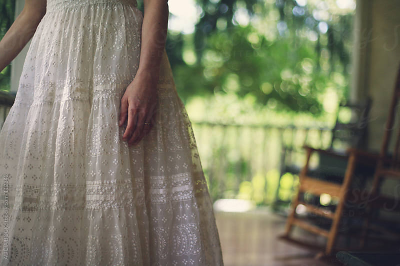 Bride On The Porch by ALICIA BOCK for Stocksy United
