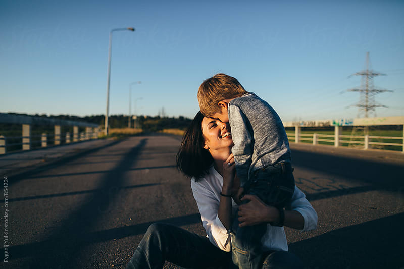 Mother hugging her boy by Evgenij Yulkin for Stocksy United