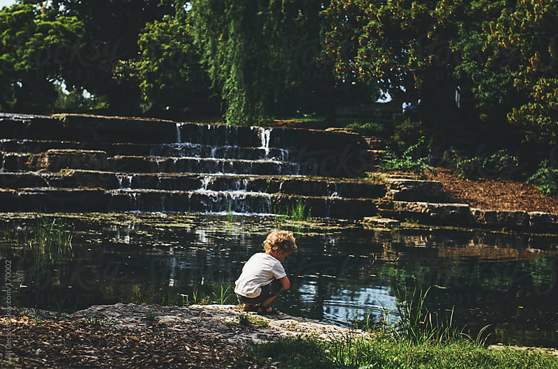 Toddler by a pond by Ali Deck for Stocksy United