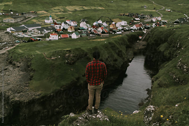 A Boy Looking at Mountains and Nature in Gjogv, Faroe Islands by Rachel Gulotta Photography for Stocksy United