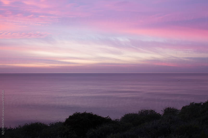 Purple and pink sunrise along the Pacific coast. by Robert Zaleski for Stocksy United