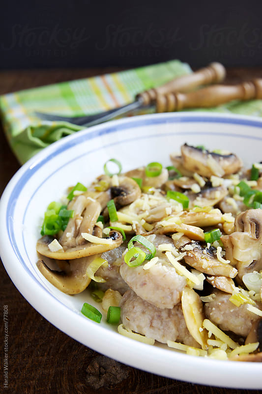 Buckwheat Gnocchi with Chestnut Mushroom and Vegan Cheese by Harald Walker for Stocksy United