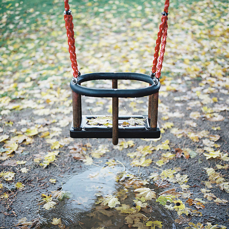 A swing a bright autumn day by Atle Rønningen for Stocksy United