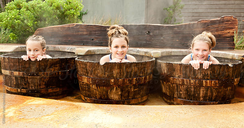 hot springs wooden tubs by Gillian Vann for Stocksy United