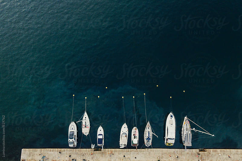 Boats in a Marina  by Lumina for Stocksy United