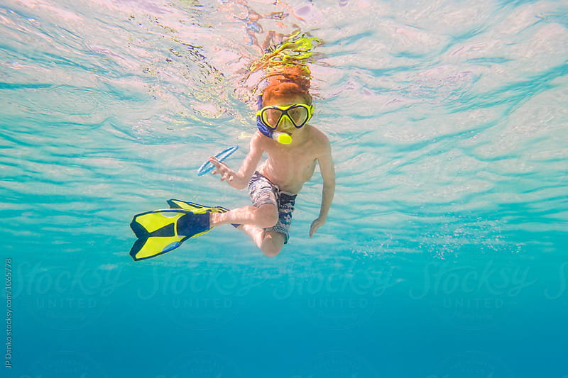 Boy with Diving Ring Swimming Snorkeling Underwater at All Inclusive Caribbean Resort White Sand Beach by JP Danko for Stocksy United