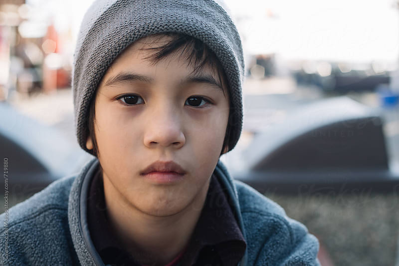 Portrait of a young emotional boy by Lawrence del Mundo for Stocksy United