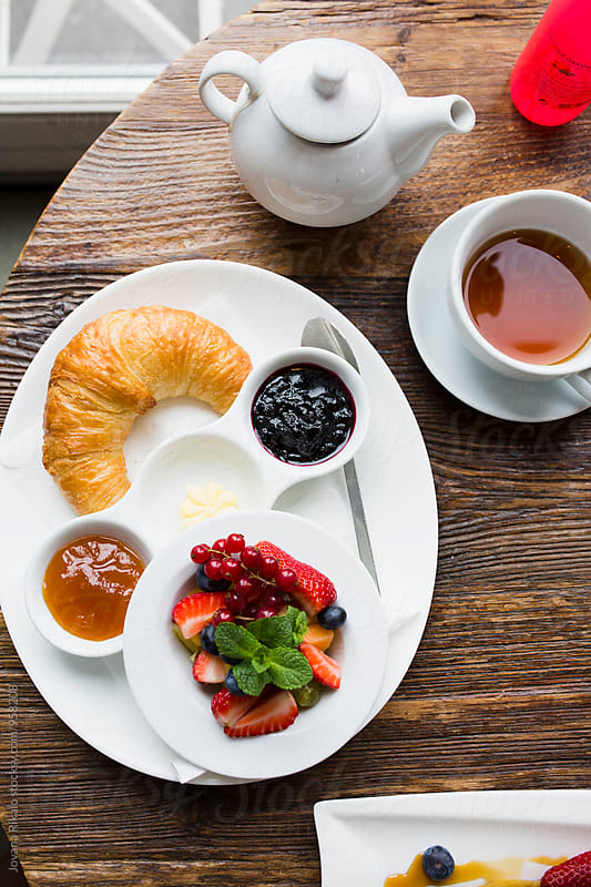 Croissant with fruits for breakfast by Jovana Rikalo for Stocksy United