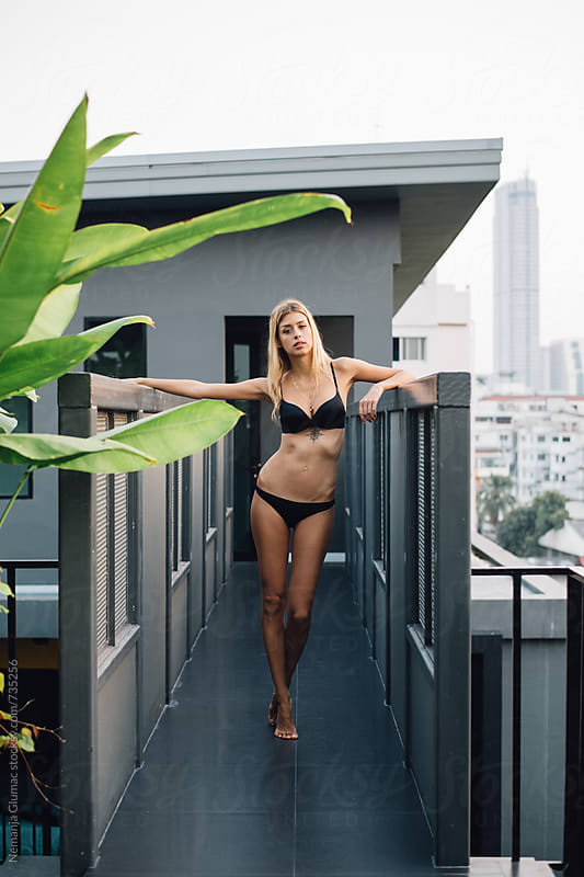 Attractive Blonde Model in Bikini Posing on Terrace by Nemanja Glumac for Stocksy United