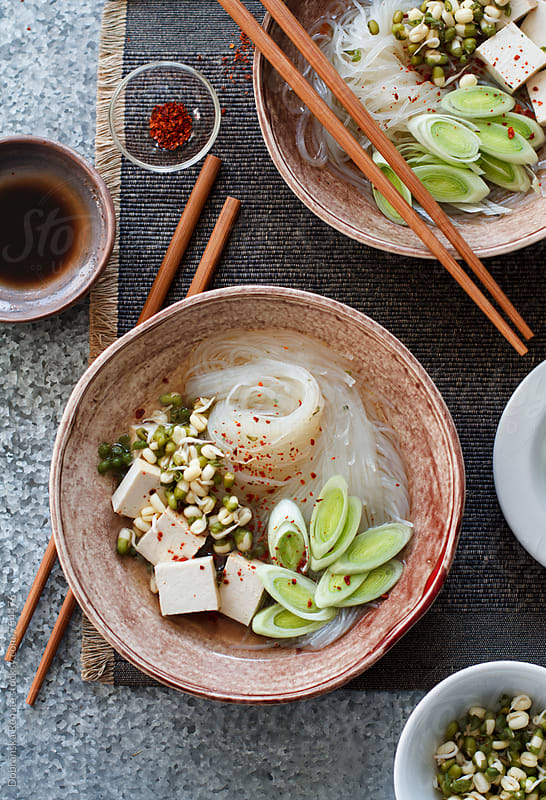 Asian noodle soup with smoked tofu and leeks by Dobránska Renáta for Stocksy United