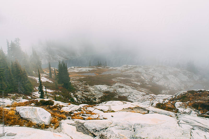 Rocky Granite Slopes And Mountain Lake In Foggy Subalpine Forest  by Luke Mattson for Stocksy United