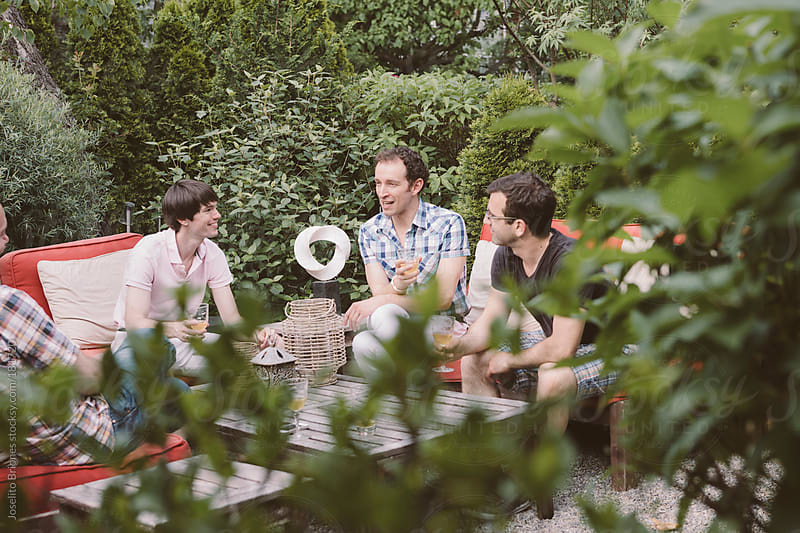 Group of Gay Men Friends Having Spring Drinks Party in a Home Backyard Garden by Joselito Briones for Stocksy United