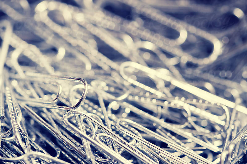 Macro of office paper clips by Kerry Murphy for Stocksy United