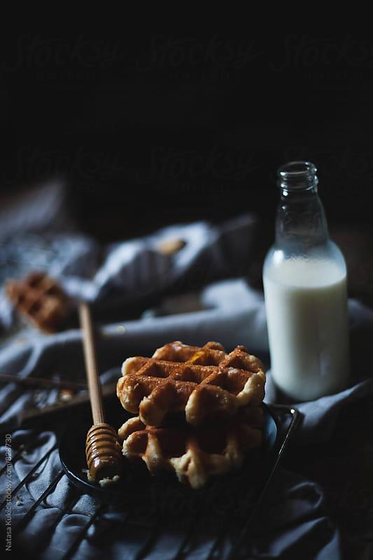 Waffles,honey and milk still life by Natasa Kukic for Stocksy United