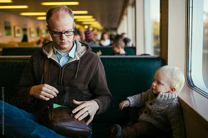 Father and Son Together on a Ferry by Amanda Voelker for Stocksy United