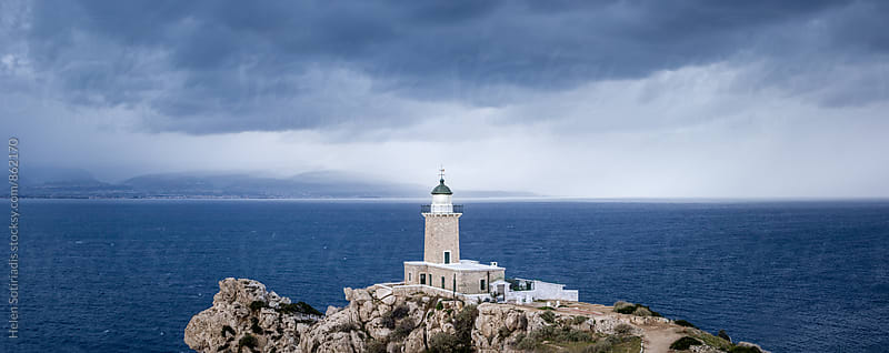 Lighthouse Against a Moody Sea Panorama by Helen Sotiriadis for Stocksy United