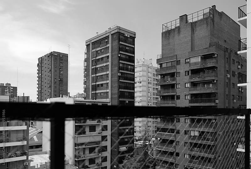 buildings in black and white taken from a balcony  by Leandro Crespi for Stocksy United