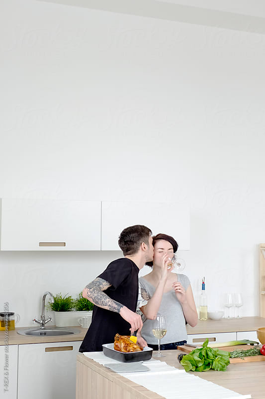 Couple cooking at home by Danil Nevsky for Stocksy United