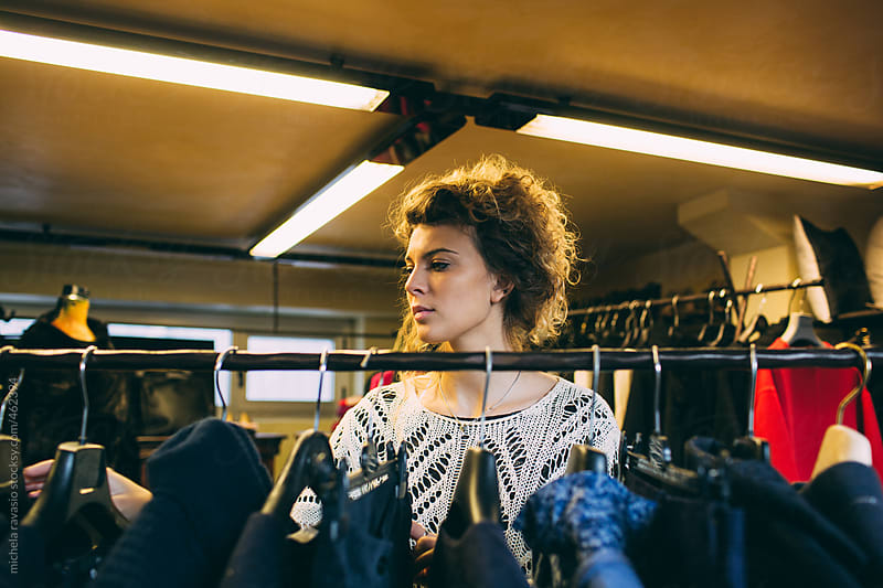 Young woman shopping for clothes by michela ravasio for Stocksy United
