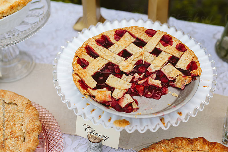 Fresh Baked Cherry Pie On Dessert Table by Luke Mattson for Stocksy United