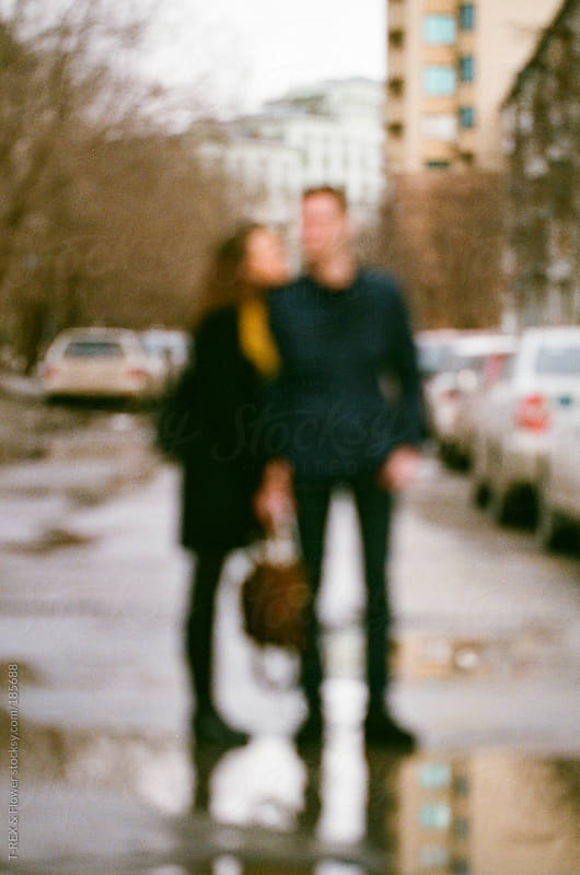 Blurred couple at walk by T-REX & Flower for Stocksy United