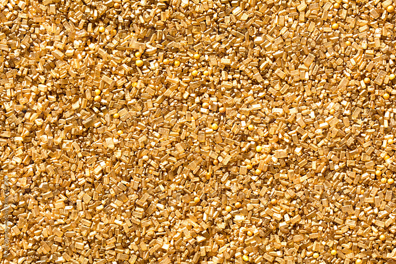 Golden sanding sugar background by Pixel Stories for Stocksy United