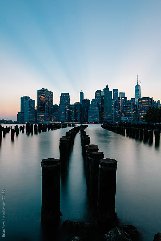 view of Manhattan at dusk by Brian Powell for Stocksy United