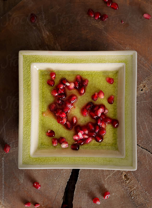Pomegranate  Seeds on Green Plate by Studio Six for Stocksy United