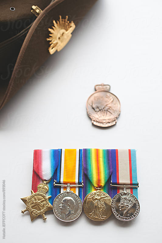 Close up of  Australian army service and war medals, ANZAC medallion and slouch hat by Natalie JEFFCOTT for Stocksy United