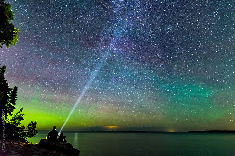 Father & Son Watching Perseids Meteor Shower With Milky Way and Northern Lights On Summer Vacation by JP Danko for Stocksy United