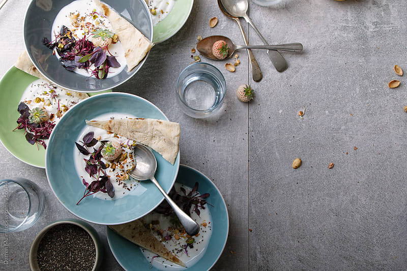 Savoury yogurt breakfast with flat bread. by Darren Muir for Stocksy United