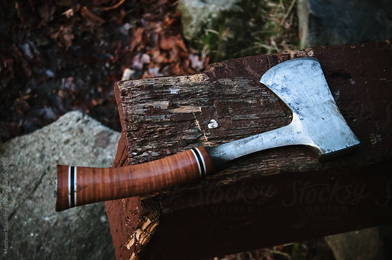 Sharp hatchet hand tool on old wood by Matthew Spaulding for Stocksy United