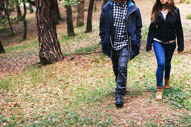 Anonymous couple walking in the forest on winter. by BONNINSTUDIO for Stocksy United
