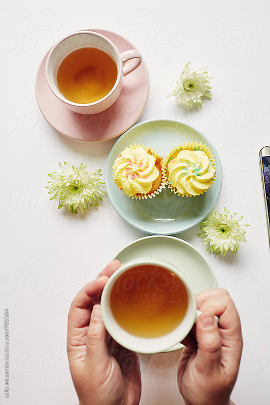 Tea and cupcake by sally anscombe for Stocksy United