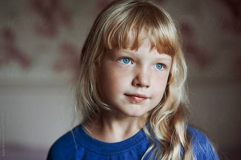 Portrait of a girl in a blue t-shir by Svetlana Shchemeleva for Stocksy United
