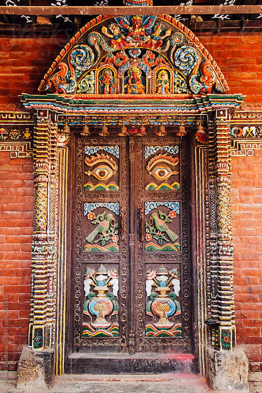 Intricately carved wooden doors in a temple in Kathmandu, Nepal. by Shikhar Bhattarai for Stocksy United