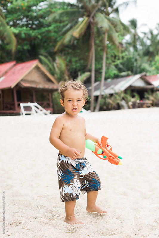 Little Boy Playing with a Watergun by Mosuno for Stocksy United