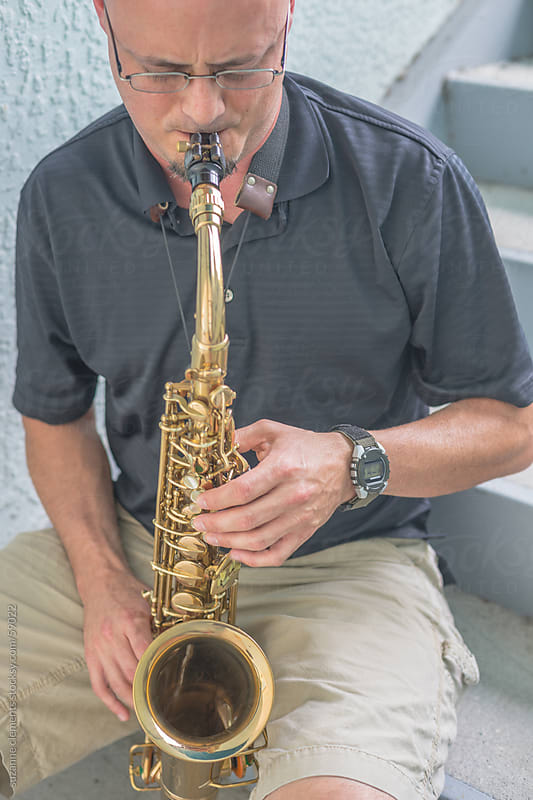 Saxaphone Musician Demonstrates his Musical Talent by suzanne clements for Stocksy United