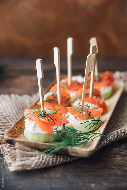 Food: Lox, Horseradish cream and cucumber with dill Fingerfood by Ina Peters for Stocksy United