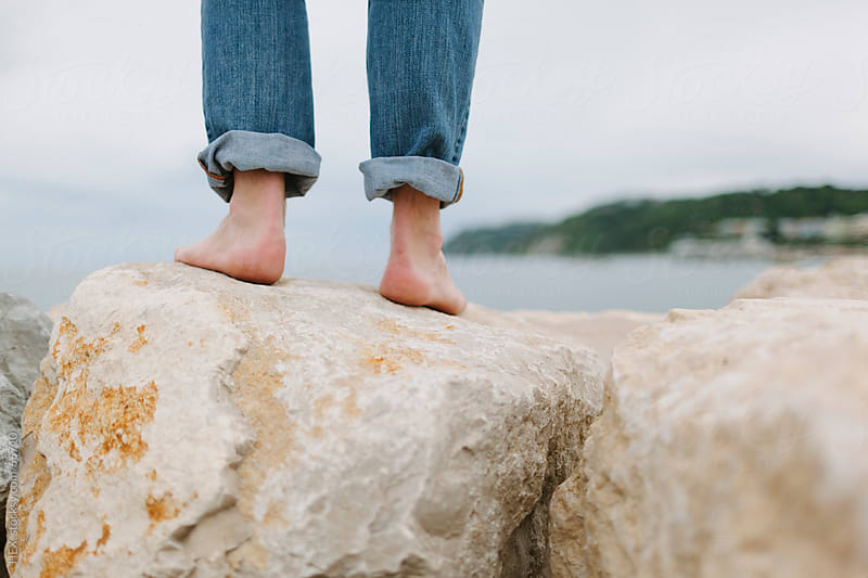 Walking Barefoot on Rocks by HEX. for Stocksy United