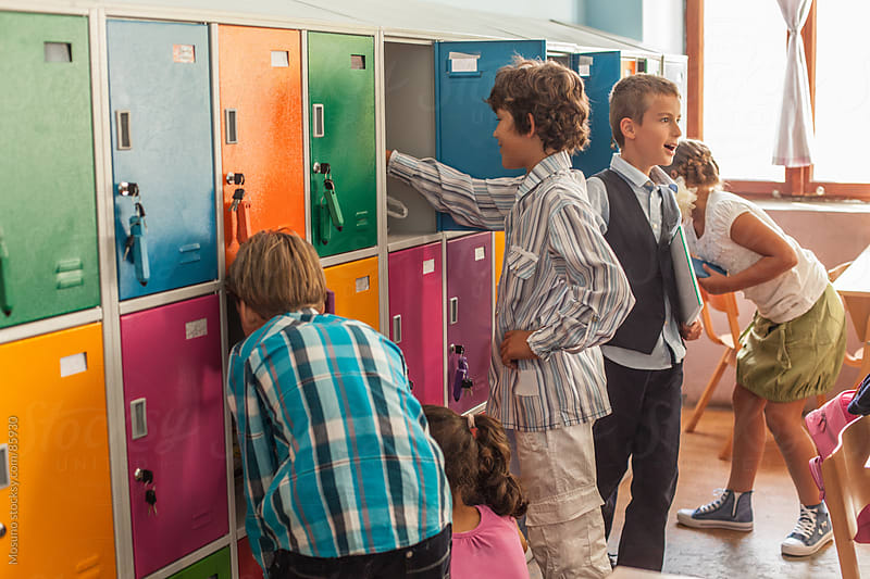 Schoolchildren Using Their Lockers After Class by Mosuno for Stocksy United
