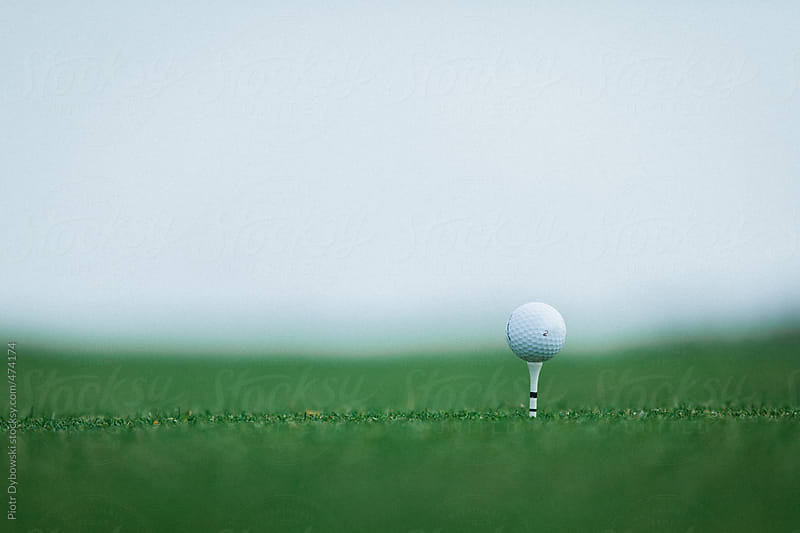 Golf ball ready to be hit by Big Smoke Studio for Stocksy United