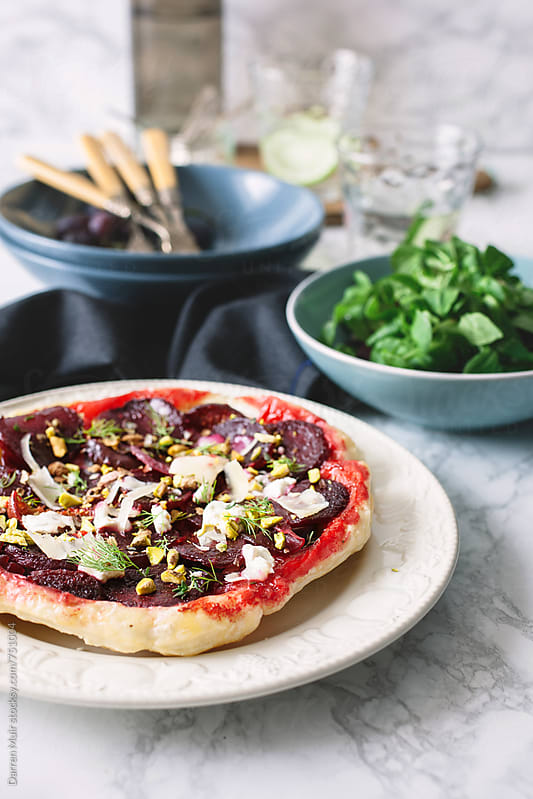 Beetroot and goats cheese tart.  by Darren Muir for Stocksy United