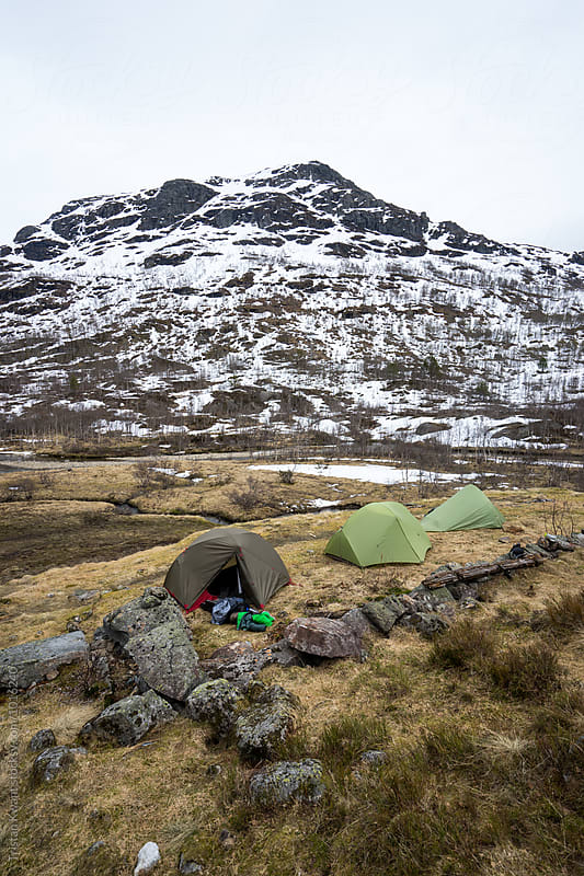 three tents in the mountains during winter. by Tristan Kwant for Stocksy United