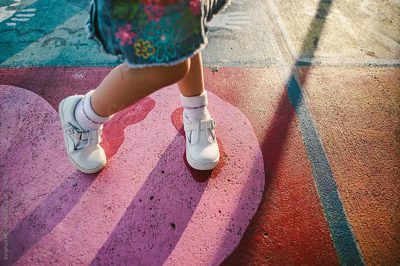 Little Girl's Feet in Playground by Stephen Morris for Stocksy United
